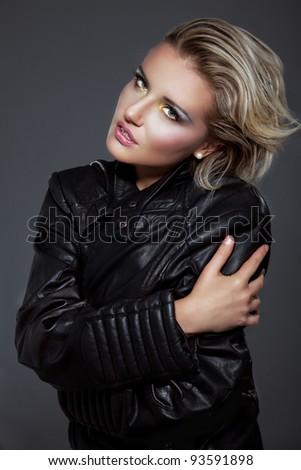 Beauty rock woman in a black leather jacket - stock photo