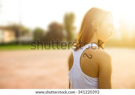 Beauty Romantic Girl Outdoors. Beautiful Teenage Model girl Dressed in Casual Short Dress outdoor in Sun Light. summer. Glow Sun, Sunshine.Toned in warm colors - stock photo