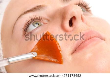 beauty salon, facial peeling mask with retinol and fruit acids - stock photo
