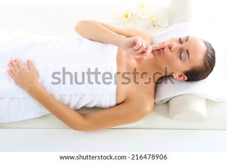 Beauty salon, the woman at face massage .Attractive brunette woman in spa salon. - stock photo