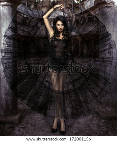 Beauty sensual woman in black dress - stock photo