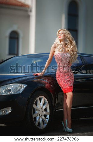 Beauty sexy woman portrait luxury life, Fashionable vogue girl with car bright makeup long blond hair. beautiful blonde lady at sunset. Beautiful fashionable young woman. series - stock photo