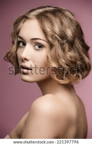 beauty shoot of pretty girl with short curly blonde hair-cut and natural make-up.  - stock photo