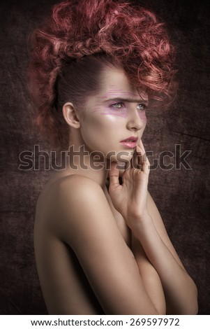 beauty shoot of stunning female with aggressive fashion style, rock red hairdo and punk creative make-up. Perfect skin, angelic expression   - stock photo
