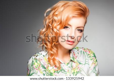 beauty shot of beautiful blonde woman wearing professional make-up on - stock photo