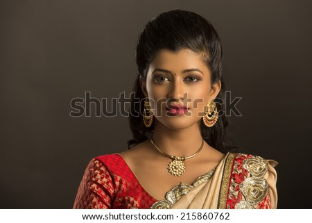 Beauty shot of Beautiful Indian women with jewelry  - stock photo