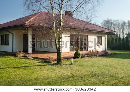 Beauty single-family home on sunny day - stock photo