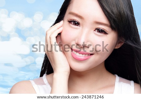 Beauty Skin care concept, Beautiful woman face and long hair with Water splashes blue background, asian beauty - stock photo