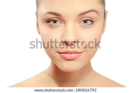 Beauty skin care face portrait of young woman looking at camera isolated on bright white background. Perfect skin complexion of Caucasian beautiful gorgeous girl. - stock photo
