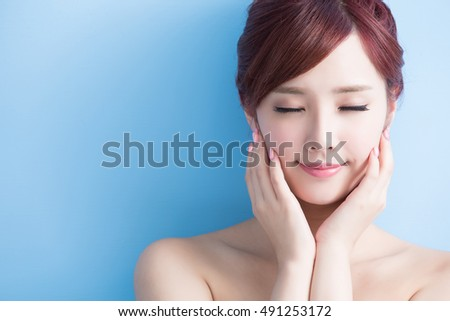 beauty  skin concept. woman relaxed. closed eyes. isolated on blue background, asian