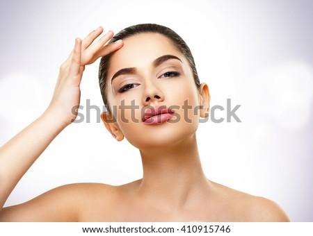 Beauty Skin Portrait. Face of Beautiful Young Woman - stock photo