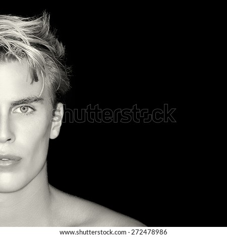 Beauty Skincare and Haircare concept. Handsome young man on black background. Perfect skin. Man half face portrait - stock photo