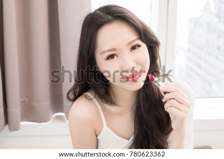 beauty skincare woman take lipstick in the home
