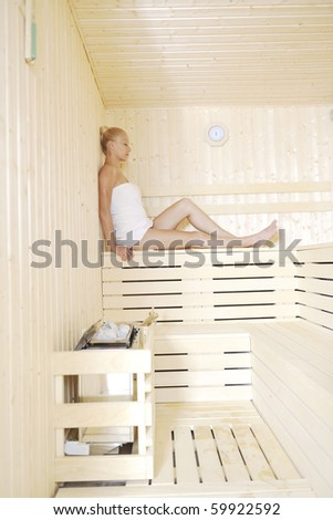 beauty spa and wellnes body treatment with young woman at  wooden sauna - stock photo
