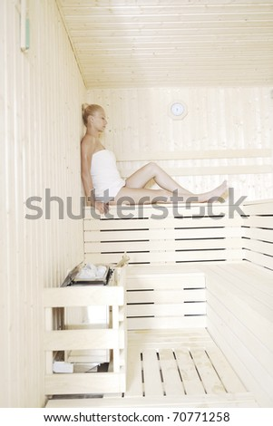 beauty spa and wellness body treatment with young woman at  wooden sauna