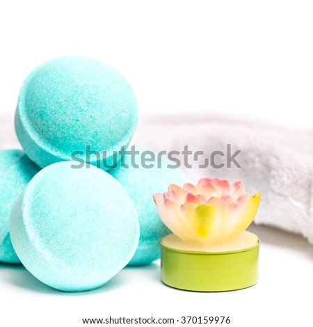 Beauty spa, bath bomb, aroma cosmetic soap with candles and towel. Natural aromatherapy ball for care, wellness, health, treatment, hygiene, relaxation. Relax bathroom.  - stock photo