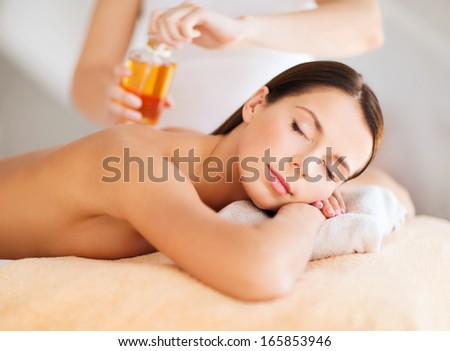 beauty, spa, resort and relaxation concept - beautiful woman in spa salon - stock photo