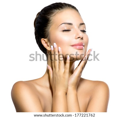 Beauty Spa Woman Portrait. Beautiful Girl Touching her Face. Perfect Fresh Skin. Pure Beauty Model Girl. Youth and Skin Care Concept. Pampering Skin. Health Care concept. Isolated on white background - stock photo