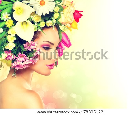Beauty Spring Girl with Flowers Hair Style. Beautiful Model woman with Blooming flowers on her head. Nature Hairstyle. Summer. Holiday Creative Makeover. Fashion Makeup. Make up. Vogue Style Portrait
