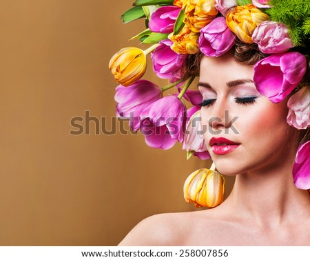 Beauty Spring Girl with Flowers Hair Style.  Spring Flower.Mother's Day. Springtime.