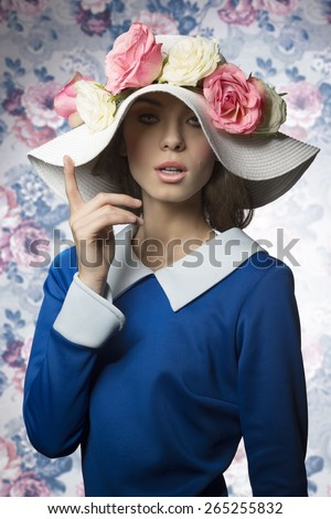 beauty spring portrait of young old style woman posing with her white hat with roses pink - stock photo