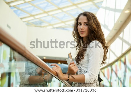 Beauty student in campus with book - stock photo