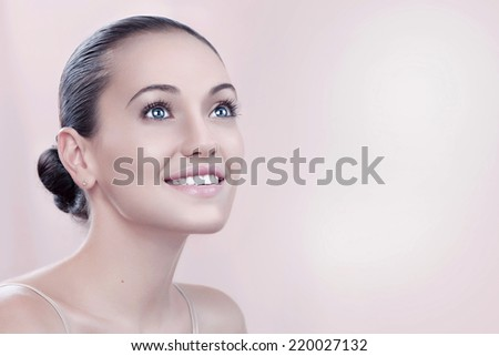 beauty style portrait of young nice woman on pink back