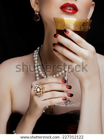 beauty stylish redhead woman with hairstyle and manicure wearing jewelry - stock photo
