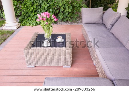 Beauty summer house with wicker garden furniture - stock photo