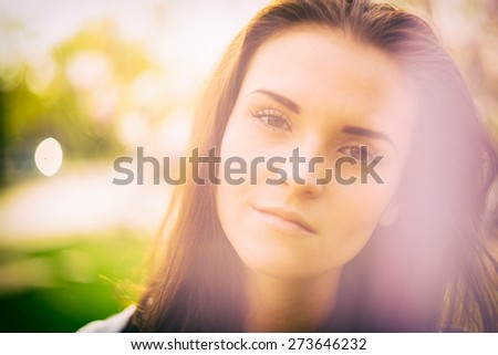 Beauty sunshine outdoor portrait of pretty girl