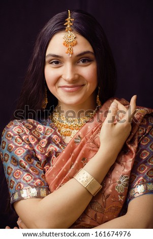 beauty sweet indian girl in sari smiling - stock photo