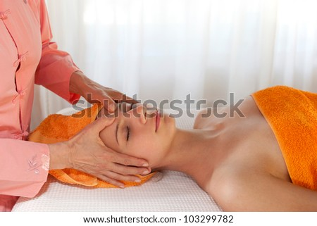 Beauty Therapist Giving Facial Massage