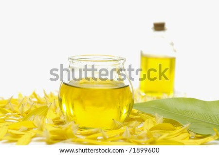 beauty treatment- bottle of massage oil and candle - stock photo