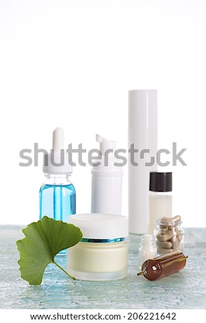 beauty treatment -Natural cosmetics product with ginkgo biloba fresh leaves -  - stock photo