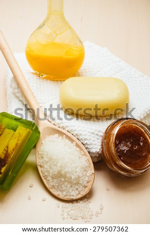 Beauty treatment therapy and skin care. Closeup spa products some bath accessories on wooden table. - stock photo