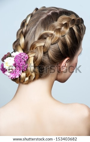 Beauty wedding hairstyle with wlowers. Bride - stock photo