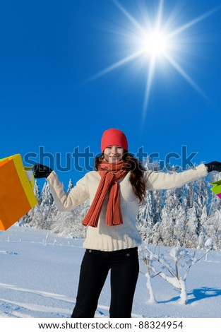 Beauty with Bags Enjoying the Snow - stock photo