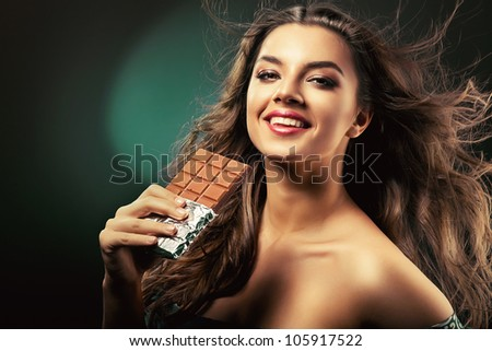 beauty with bar of chocolate - stock photo