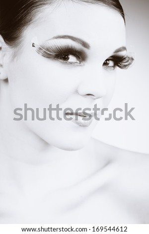 Beauty with giant lashes in monochrome tones