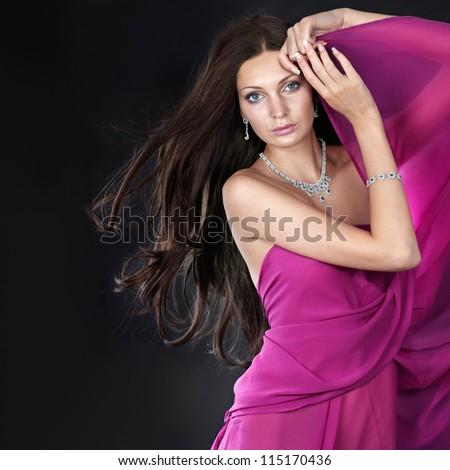 Beauty with jewelry on dark background - stock photo