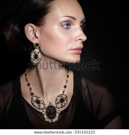 Beauty with stylish jewelry - stock photo