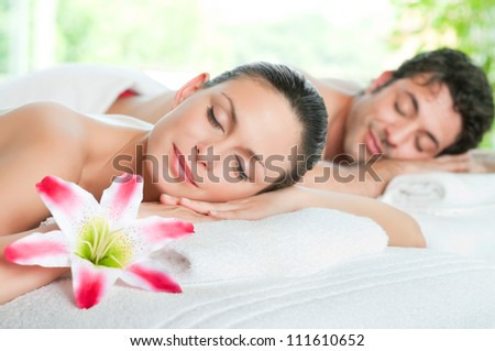 Beauty woman and man relaxing together during a spa treatment - stock photo