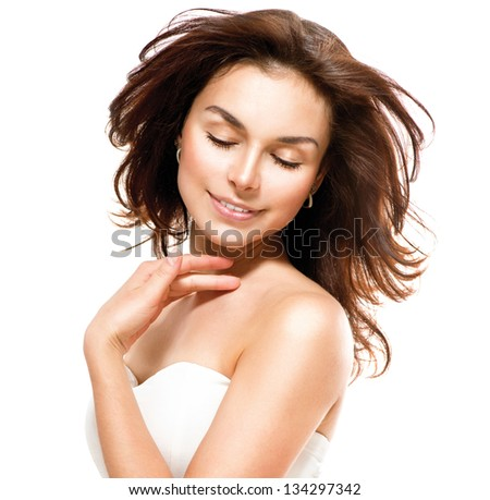 Beauty Woman. Beautiful Young Female Portrait isolated on White Background. Healthcare. Perfect Skin. Beauty Face. Professional Makeup - stock photo