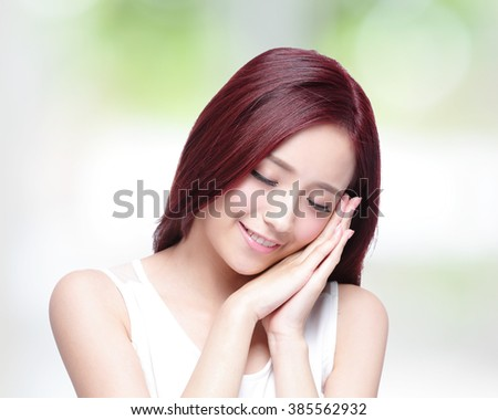 Beauty woman carefree and closed eyes with health skin, and hair with nature green background, asian beauty - stock photo