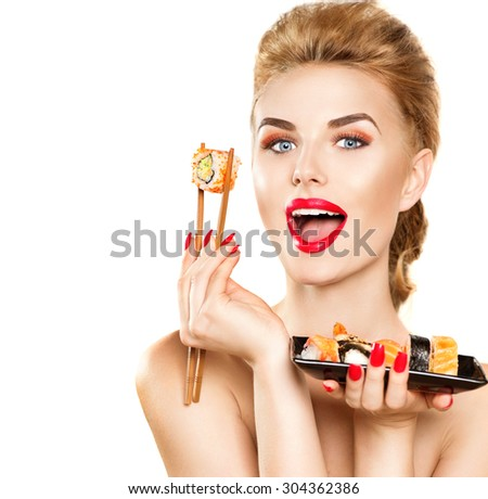 Beauty Woman eating Sushi. Beauty Fashion model girl eating Sushi rolls. Chopsticks. Beautiful sexy surprised lady with perfect make up eating healthy japanese food. Diet, dieting concept - stock photo