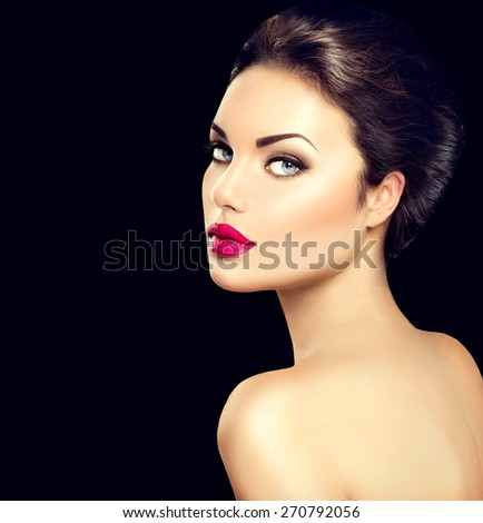 Beauty woman face closeup isolated on black background. Beautiful model girl makeup. Gorgeous lady with blue eyes and brown hair. Perfect skin. Professional make up. Red lips - stock photo