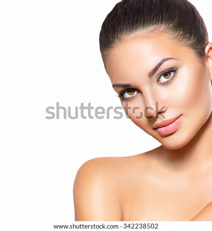 Beauty Woman face Portrait. Beautiful Spa model Girl with Perfect Fresh Clean Skin. Brunette female looking at camera and smiling. Youth and Skin Care Concept. Isolated on a white background - stock photo