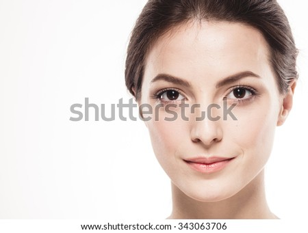Beauty Woman face Portrait. Beautiful Spa model Girl with Perfect Fresh Clean Skin. Brunette female looking at camera and smiling. Youth and Skin Care Concept. Isolated white background - stock photo