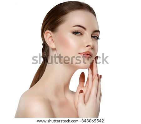 Beauty Woman face Portrait Girl with Perfect Fresh Clean Skin female looking at camera smiling.Youth and Skin Care Concept.Cheerful girl is touching her cheeks pleasure.Isolated
