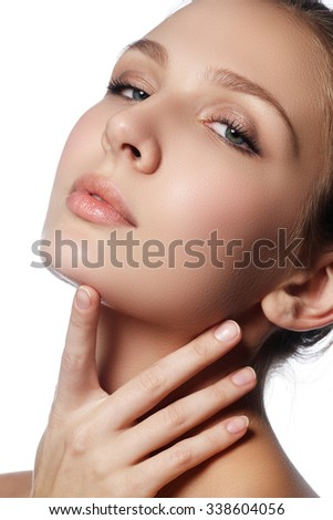 Beauty woman face portrait. Spa model girl with perfect fresh clean skin. Woman looking at camera and smiling. Youth and skin care concept. Beauty and wellness
